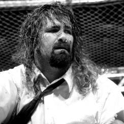 WWE Raw: Mick Foley loses HIAC tooth (video)