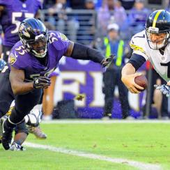 Ravens linebacker Terrell Suggs and Steelers quarterback Ben Roethlisberger a moment before colliding in their Week 9 matchup.