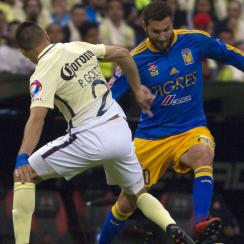 Andre Pierre Gignac scores for Tigres against Club America in the Liga MX final first leg