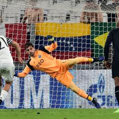 Paulo Dybala scores on a penalty kick for Juventus vs. Porto in Champions League