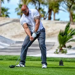 Dwayne 'The Rock' Johnson says he was just 25 yards off the Guinness World Record for longest drive.