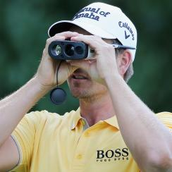 Henrik Stenson checks a yardage with a rangefinder during a pro-am prior to The Barclays in 2015.