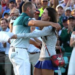 Sergio Garcia embraces his fiancee Angela Akins after winning the Masters.