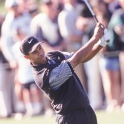 Tiger Woods plays a shot during his first round at the 1997 Masters.