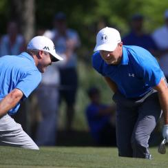 Teammates Jordan Spieth and Ryan Palmer react to their shot on the 14th hole during the first round of the Zurich Classic.