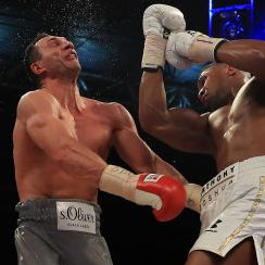 Anthony Joshua (White Shorts) and Wladimir Klitschko (Gray Shorts) in action during the IBF, WBA and IBO Heavyweight World Title bout at Wembley Stadium on April 29, 2017 in London, England