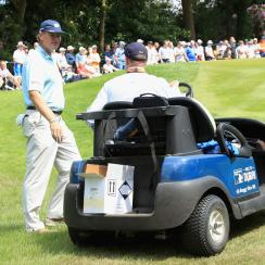 Ernie Els talks to rules official Simon Higginbottom on the 14th hole during day one of the BMW PGA Championship.