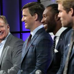 Roger Goodell hosted a fan forum in February with Walter Payton Man of the Year finalists (from left to right) Eli Manning, Larry Fitzgerald and Greg Olsen.