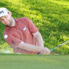 Branden Grace plays from a bunker on the 18th hole during day one of the BMW PGA Championship at Wentworth.