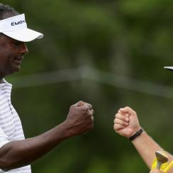 Vijay Singh leads the wind-delayed 2017 Senior PGA Championship by one shot.