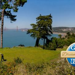 A golfer at Lincoln Park Golf Course with views of the Golden Gate Bridge.