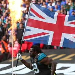 A Jaguars player runs out with the Union Jack before an NFL game at Wembley Stadium in London in 2017.