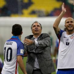 Bruce Arena, Christian Pulisic and Michael Bradley celebrate after the USA's 1-1 draw in Mexico
