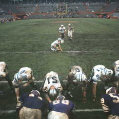 Before a mostly empty stadium at the Orange Bowl, the Cowboys' Mike Clark kicks a field goal during the Playoff Bowl against the Vikings in 1969.