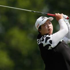 Shanshan Feng watches her tee shot on the fourth hole during the first round of the U.S. Women's Open at Trump National Golf Club.