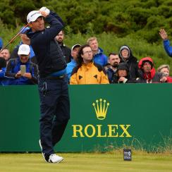 In a move reminiscent of Gary Player's, Harrington steps through with his right foot toward the target after impact.