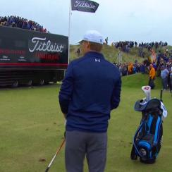 Jordan Spieth tries to find a place to make a drop on the driving range to the right of the 13th hole.
