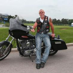Brent McLaughlin with his Harley Davidson, at the 18th green of Glen Abbey golf club.