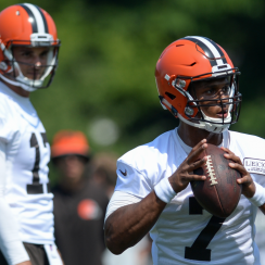 Brock Osweiler (l.) watches as DeShone Kizer goes through quarterback drills.