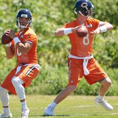 The Bears' two new quarterbacks, Mitchell Trubisky (10) and Mike Glennon, have been under the microscope at training camp.