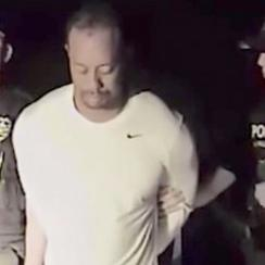 Tiger Woods, shown here in the dashcam footage later released by police, was arrested and charged with DUI on May 29.