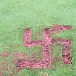 The symbol was found at Crystal Lake Golf Course early Monday as mowers cut the greens.