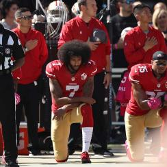 Colin Kaepernick kneels during the national anthem at a 49ers game in 2016.