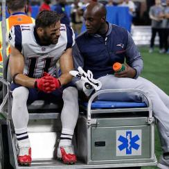 Patriots receiver Julian Edelman is carted off the field after his injury against the Lions.