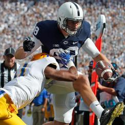 Mike Gesicki #88 of the Penn State Nittany Lions jumps into the end zone for a 10 yard touchdown catch in the first half against Ruben Flowers III #11 of the Pittsburgh Panthers at Beaver Stadium on September 9, 2017 in State College, Pennsylvania. (Photo