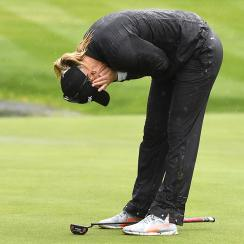 Anna Nordqvist made a five-foot bogey putt in heavy rain to win the Evian Championship.