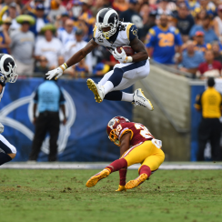 L.A. Rams running back Todd Gurley leaps over a defender.