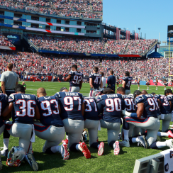 Week 3 in the NFL: The New England Patriots during the national anthem on Sunday.