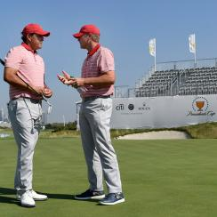U.S. Captain Steve Stricker chats with Phil Mickelson at Liberty National.
