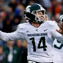 Michigan State quarterback Brian Lewerke looks to pass against Northwestern during the second half of an NCAA college football game in Evanston, Ill., Saturday, Oct. 28, 2017. (AP Photo/Nam Y. Huh)