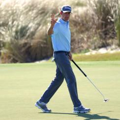 Webb Simpson waves after putting on the sixth green during the second round of the RSM Classic at Sea Island Golf Club.