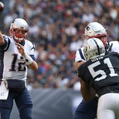 Tom Brady #12 of the New England Patriots throws a pass against the Oakland Raiders during the first half at Estadio Azteca on November 19, 2017 in Mexico City, Mexico. (Photo by Buda Mendes/Getty Images)
