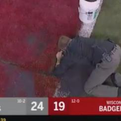 A turf issue forced a multi-minute stoppage at the Big Ten Championship Game.