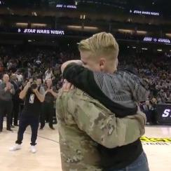 A soldier returned home to surprise his kids during Tuesday night's Kings-Suns game.