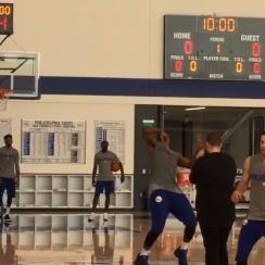 Sixers' Joel Embiid hits half-court shot backwards (video)