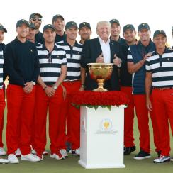 Donald Trump poses with the victorious U.S. Presidents Cup team at Liberty National.