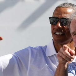 Presidents Obama and Bush took in the action on day one of the Presidents Cup in New Jersey.