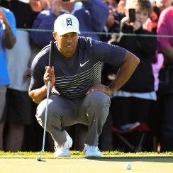 Woods birdied two of his final three holes to make the cut at the Farmers.