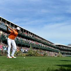 Rickie Fowler tees off on the 16th hole during the 2017 Phoenix Open. Fowler lost in a playoff in 2016.