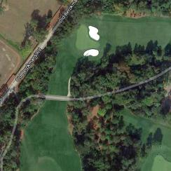 From above, the current 5th-hole teeing ground can be seen just below-left of the 4th green. The new proposal would push the tee across Old Berkmans Road, and reroute the street around the tee box.
