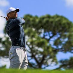 Tiger Woods plays his tee shot on the fourth hole during the third round of the Honda Classic.