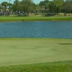 Tiger Woods watches his birdie putt on the 1st hole Sunday at the Honda Classic.