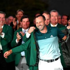 One of the many perks of winning the Masters: putting on your spiffy new green jacket for the first time.