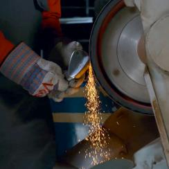 Titleist technician works on grind of Vokey wedge