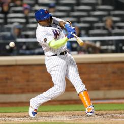 Yoenis Cespedes swings and misses during a game against the Milwaukee Brewers.