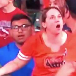 Astros fan reaches for live ball